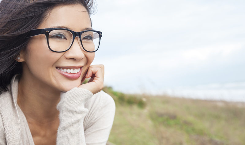 5 Ways to Look and Feel Your Best at Any Age - Asian woman with glasses smiling