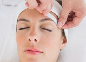 Image of a woman getting a brow wax for better shaping