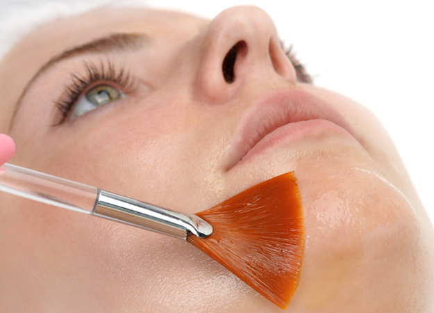 Image of a woman getting a glycolic facial