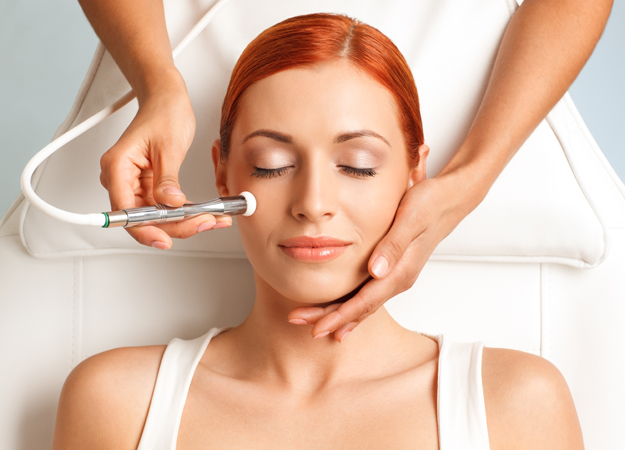 Image of a woman getting an oxygen facial