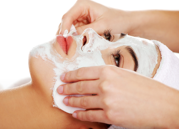 Image of a woman getting a paraffin facial