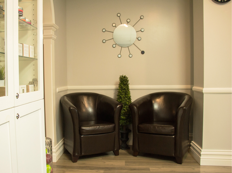 Image of two chairs held within the waiting room at The Wax Shop