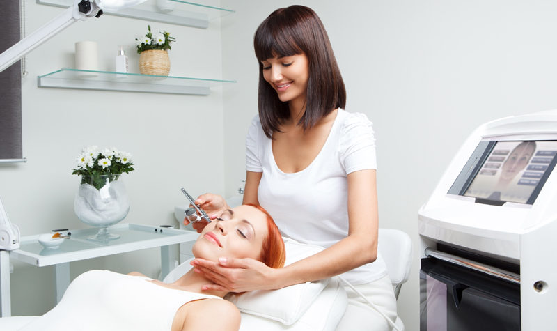 What You Should Know About Your Medical Spa - Image of a female aesthetician performing a surgery on a woman