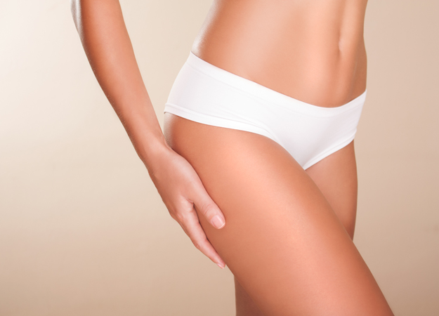 Image of a woman's bottom half wearing white panties